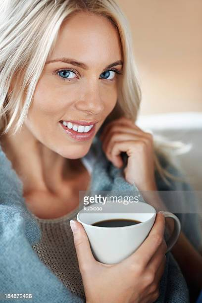 Happy young female with a cup of coffee