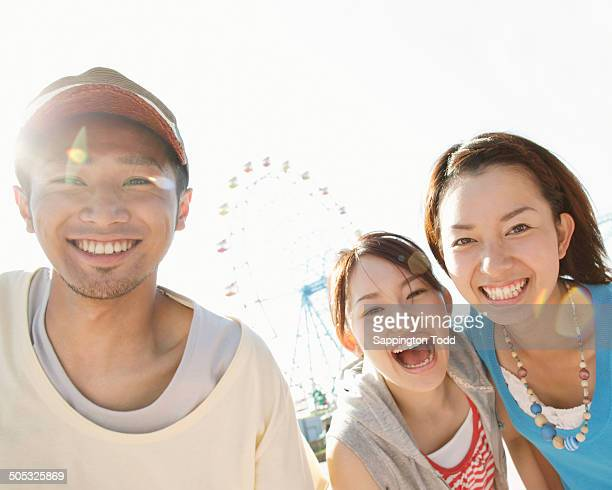 Happy Young Friends At The Amusement Park