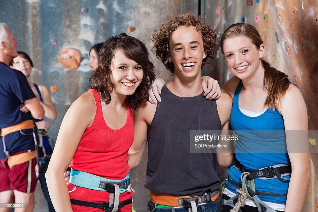 Happy young friends enjoying time at the rock climbing gym : Bildbanksbilder