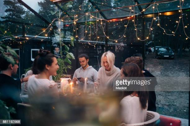 happy young friends having dinner party in cabin - dinner party stock pictures, royalty-free photos & images