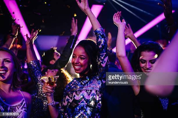 happy young friends having funny party with confetti and cocktails - black girls stock photos and pictures