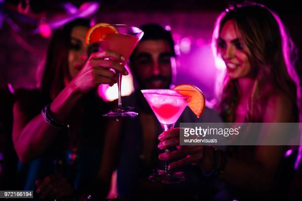 happy young friends toasting with cocktails at bar - cocktail party stock pictures, royalty-free photos & images
