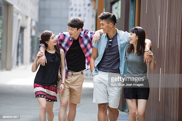 Happy young friends walking