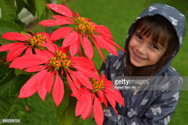 Happy young girl and red flowers
