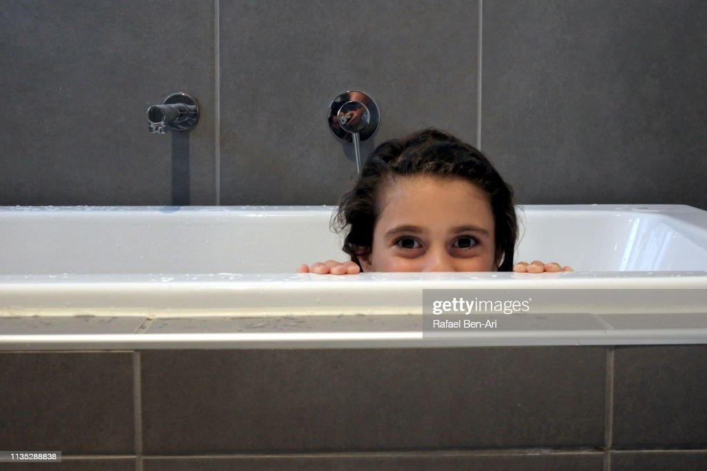 Happy young girl having a bath : Stock Photo