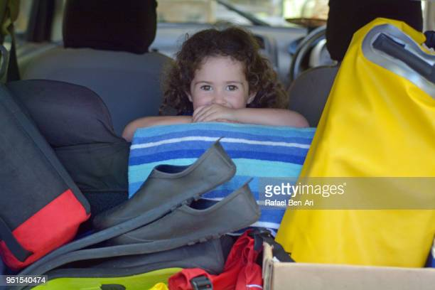 happy young girl in a car going on tropical holiday - rafael ben ari stock pictures, royalty-free photos & images