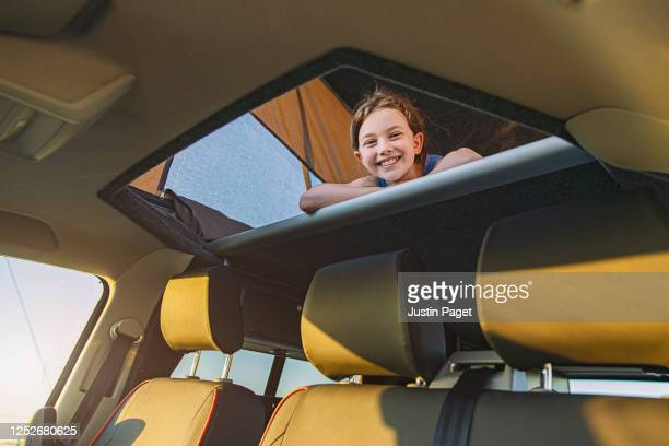 Happy young girl in her camper van