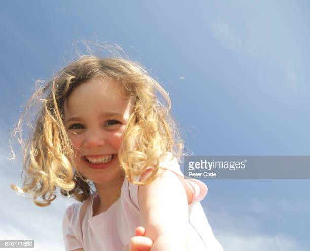 Happy young girl in sunshine