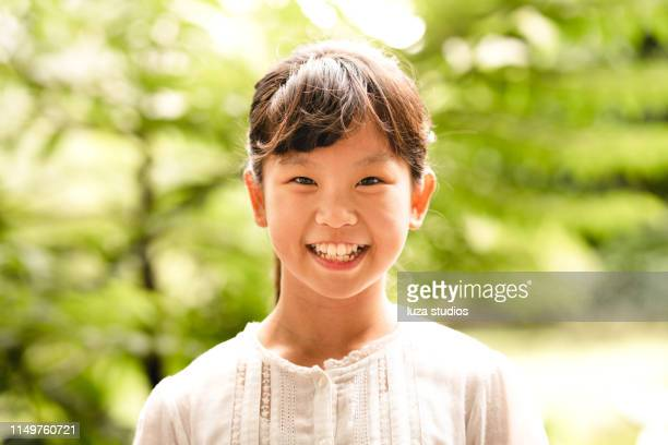 happy young girl looking at the camera and laughing - in the center stock pictures, royalty-free photos & images