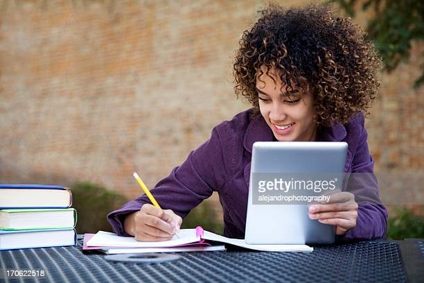 a happy young girl using a tablet - 18 19 years stock pictures, royalty-free photos & images