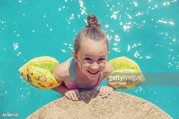 happy young girl wearing water wings - butlins stock pictures, royalty-free photos & images