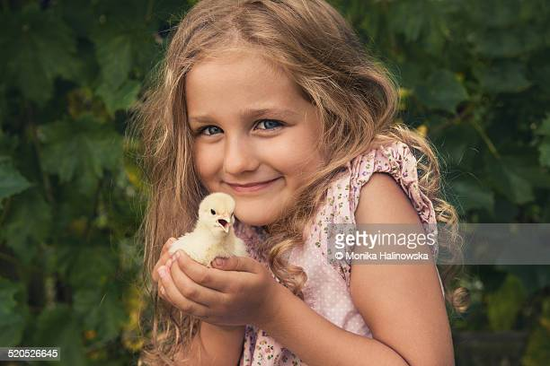 Happy young girl with chick