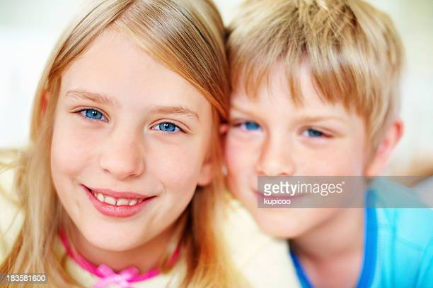 Happy, young girl with her brother smiling