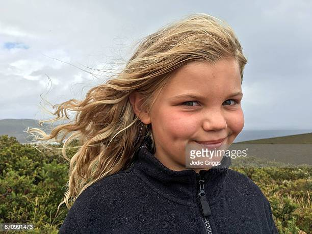 Happy young girl with wind in her hair