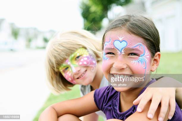 Happy young girls with painted faces