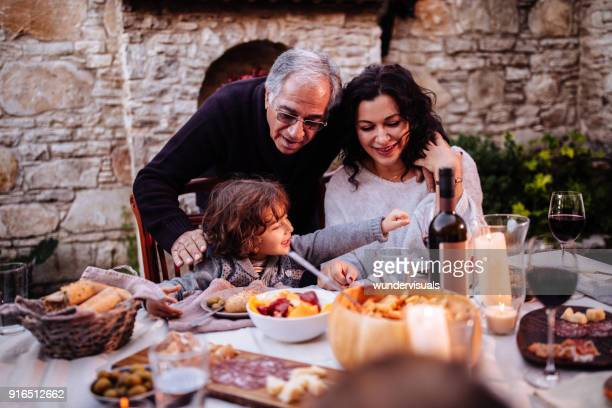 happy young grandson having lunch at grandparents rustic house - cultura mediterrânica imagens e fotografias de stock
