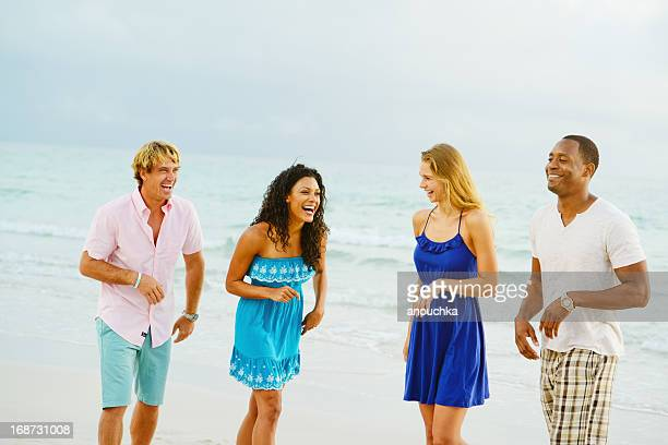 Happy Young Group of Friends Having Fun on the Beach