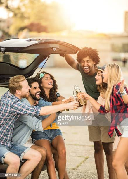 happy young group of people toasting with drinks and having fun before music festival. - next to stock pictures, royalty-free photos & images