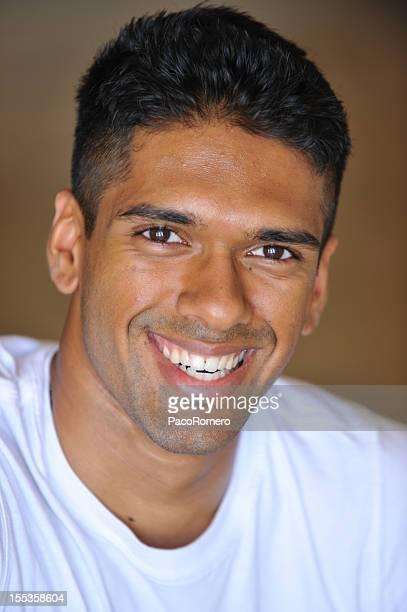 happy young indian man - handsome pakistani men fotografías e imágenes de stock