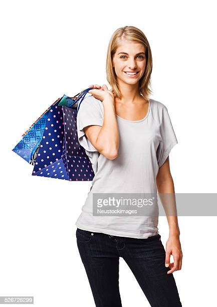 Happy young lady holding shopping bags isolated on white backgro