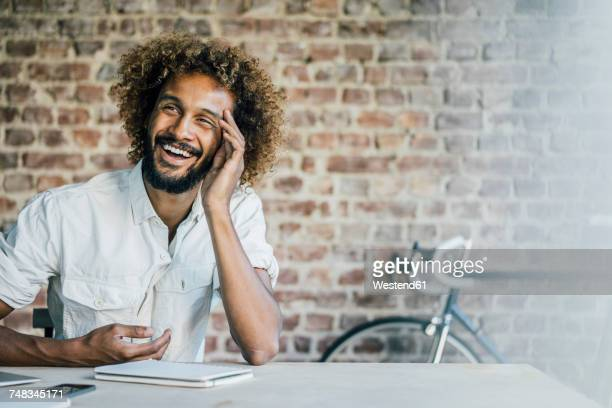 Happy young man at desk