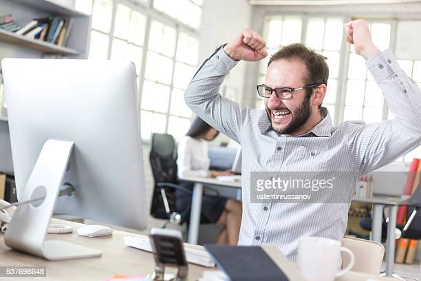 Happy young man at the office