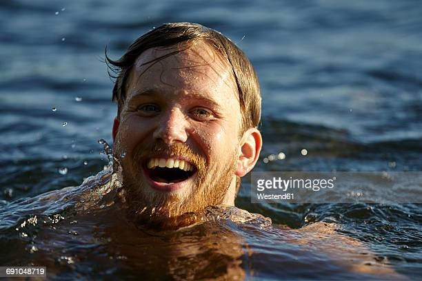 happy young man in a lake - lake auburn stock photos and pictures