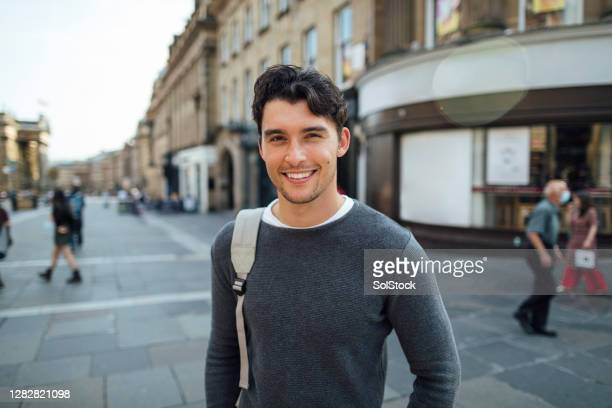 happy young man in the city - downtown stock pictures, royalty-free photos & images