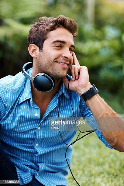 Happy Young Man Listening To Music On Headphone Stock Photo