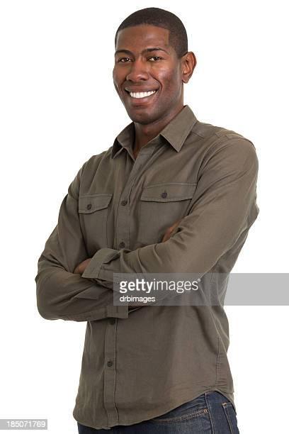 glückliche junge mann posieren mit arme verschränkt - langärmlig stock-fotos und bilder