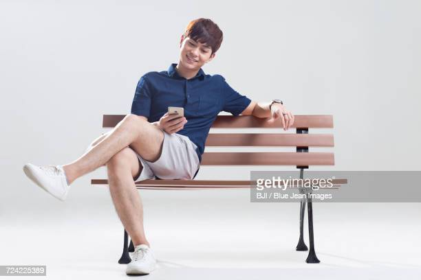 Happy young man using smart phone