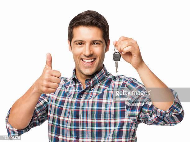 Glücklicher junger Mann mit Autoschlüssel-isoliert