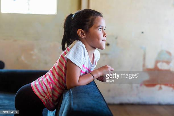 Happy Young Maori Pacific Islander Girl Relaxing at Home