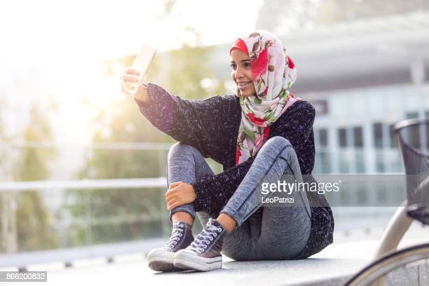 happy young muslim women - brace stock pictures, royalty-free photos & images