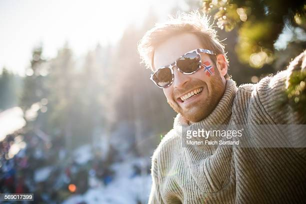 happy young norwegian man - norwegian flag stock pictures, royalty-free photos & images
