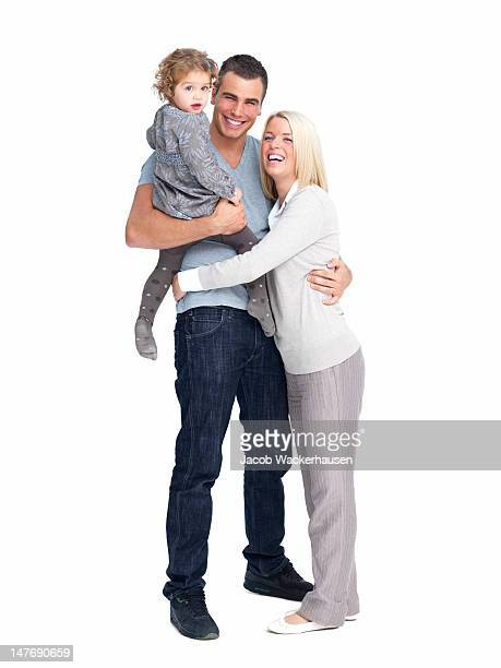Happy young parents with daughter against white background