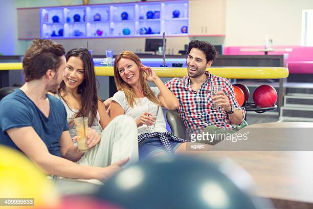 Happy Young People Bowling.