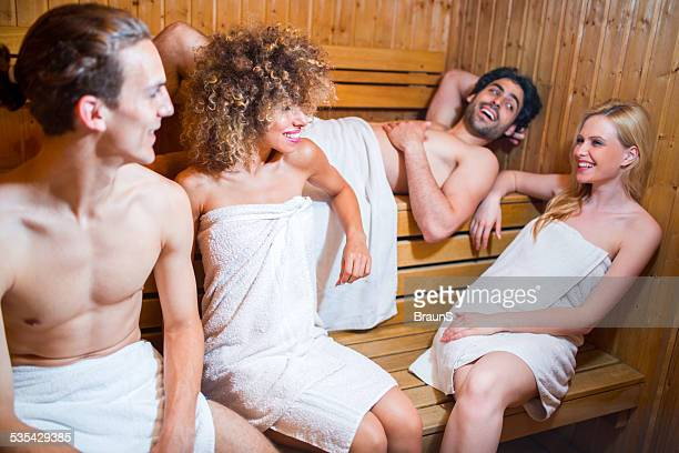 happy young people communicating in sauna. - black woman in sauna stock pictures, royalty-free photos & images