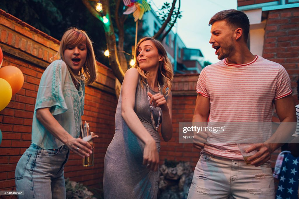 Happy Young People Dancing At Backyard Party Stock Photo