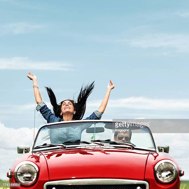 Happy young people in a cabriolet