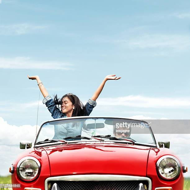happy young people in a cabriolet - convertible stock pictures, royalty-free photos & images