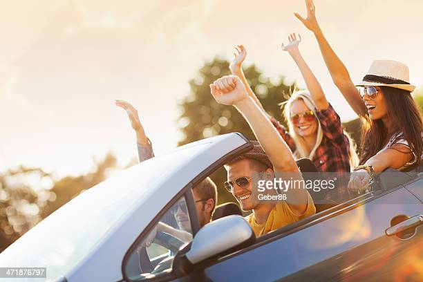 happy young people in convertible car