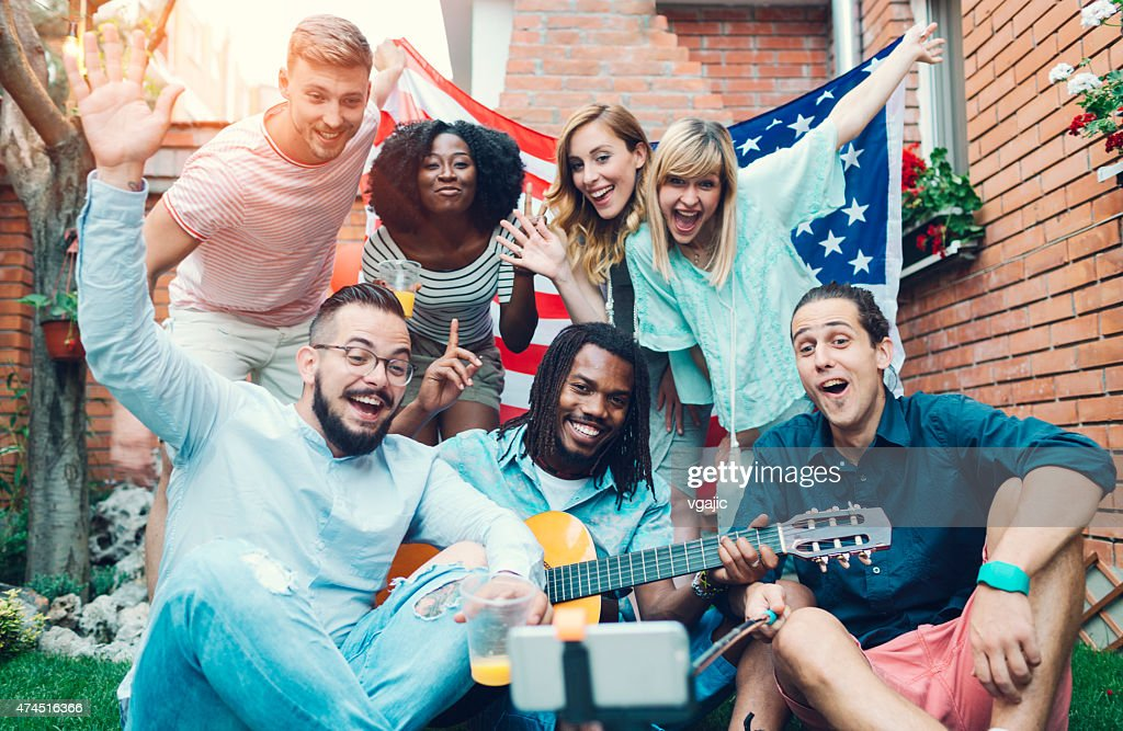 Happy Young People Making Selfie In A Backyard. : Stock Photo