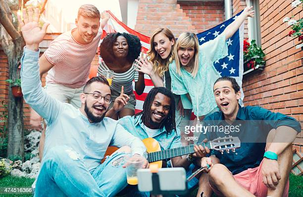 Happy Young People Making Selfie In A Backyard.