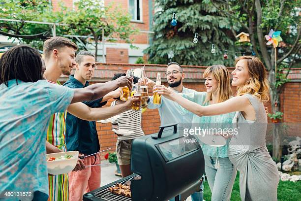 Happy Young People Toasting At Barbecue Party.