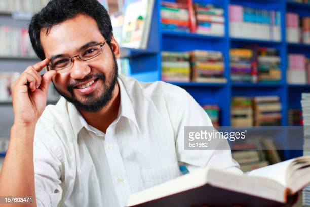 happy young professor in library