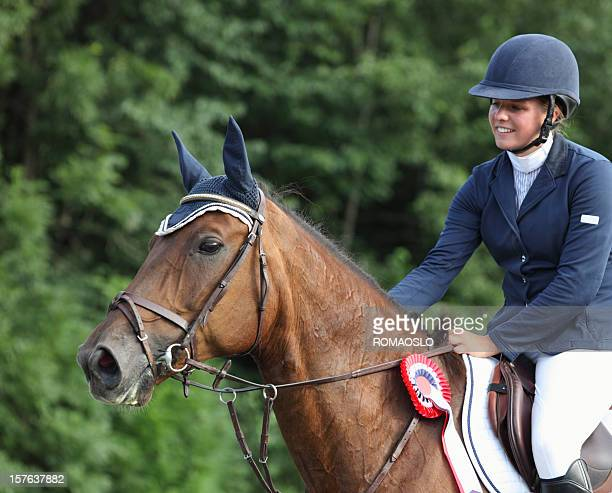 happy young rider after winning a show jumping competition, norway - equestrian show jumping stock pictures, royalty-free photos & images