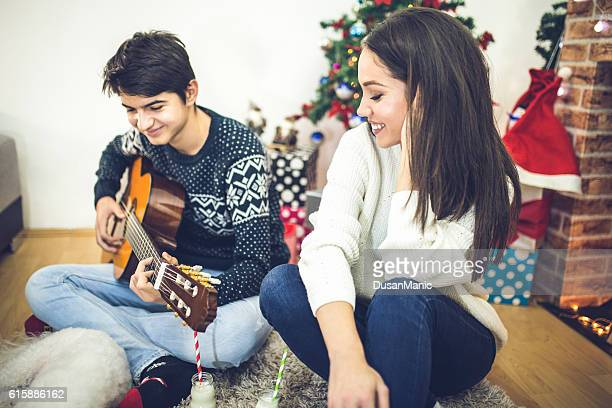 happy Young romantic couple siting in front of fireplace