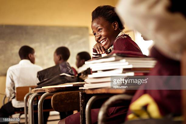 happy young south african girl with a big smile - schoolkinderen stockfoto's en -beelden