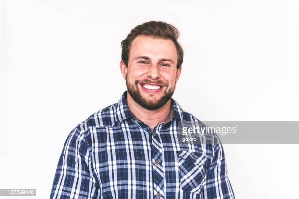 happy young strong bearded man - plaid shirt stock pictures, royalty-free photos & images